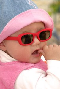 baby in red glasses